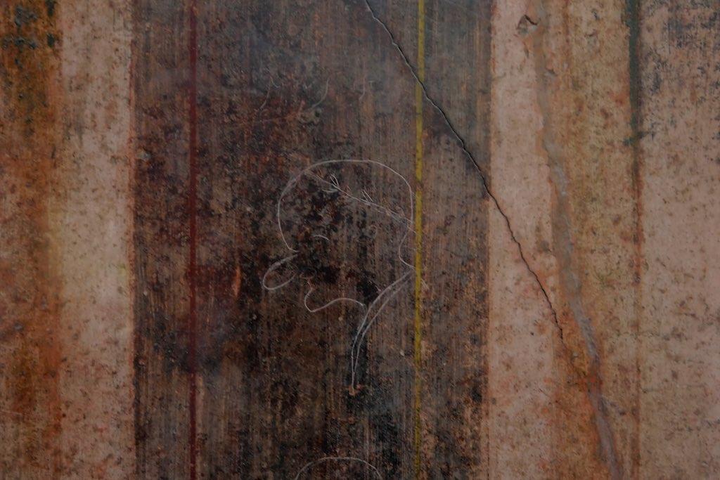 Grafitti an einer Wand in Pompeji.