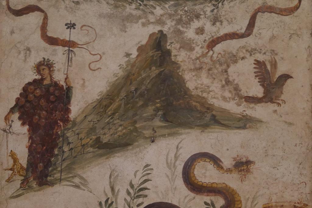 Dieses berühmte Fresko aus dem archäologischen Nationalmuseum in Neapel zeigt den Weingott Dionysos mit Trauben behängt vor dem Gipfel des Vesuvs.