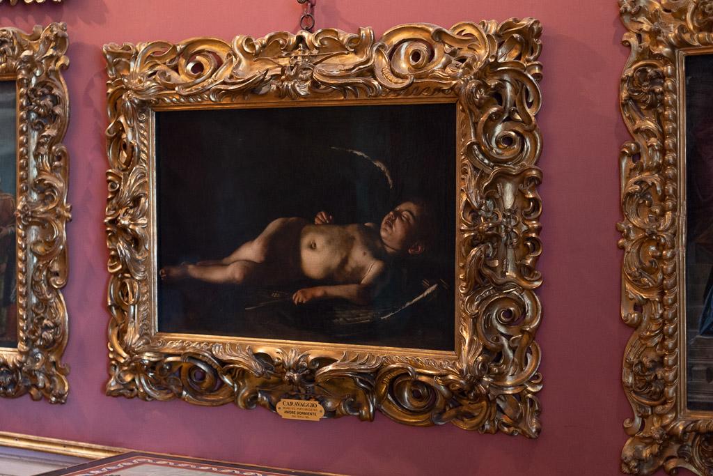 Der schlafende Amor von Caravaggio in der Galleria Palatina.
